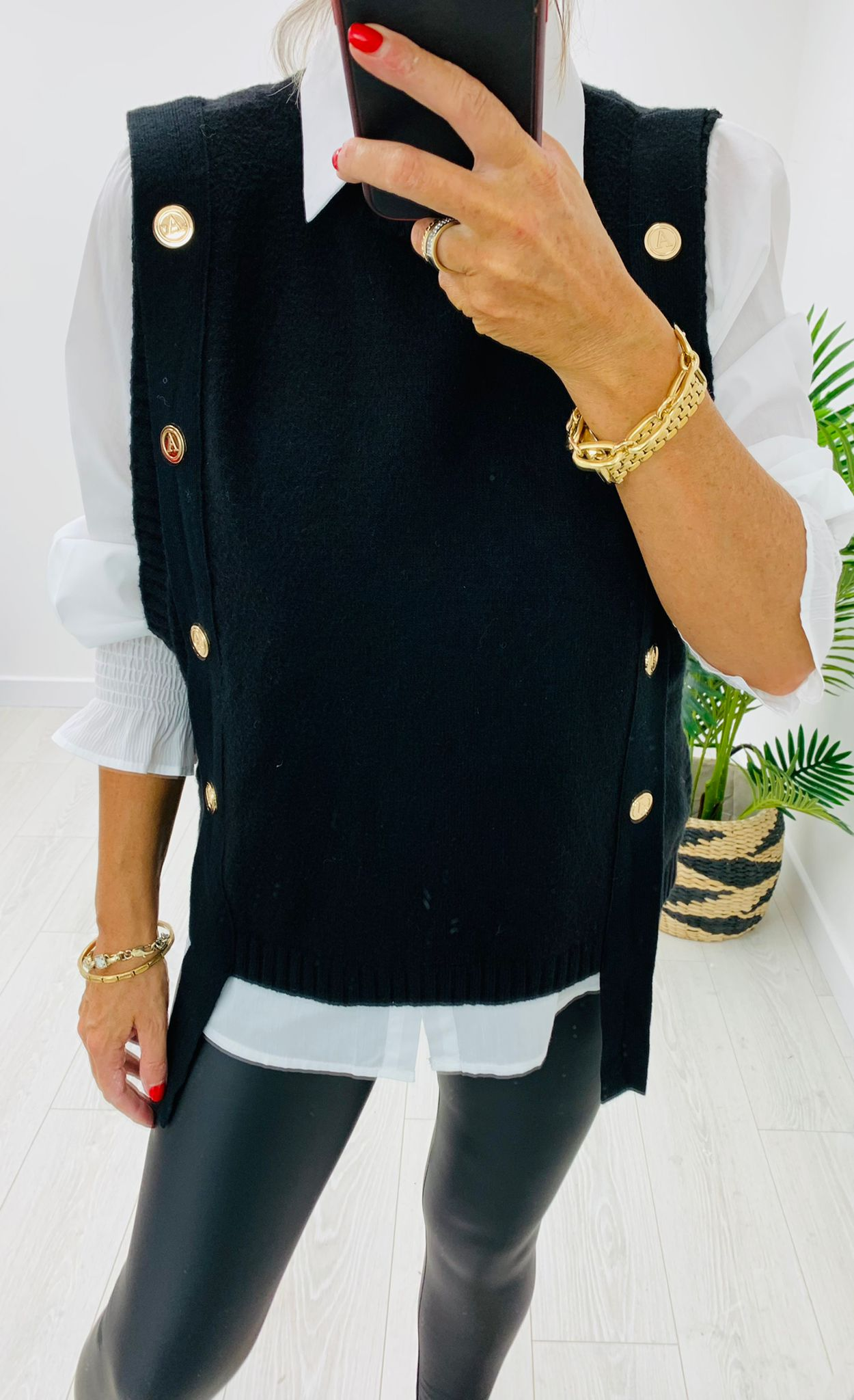 Black sweater vest with white shirt